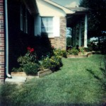 Left side showing Peggy's wrap-around flower bed. 702 Marion Street, Kings Mountain, North Carolina. Circa 1975.